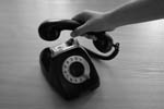 Picture of person hanging up a telephone