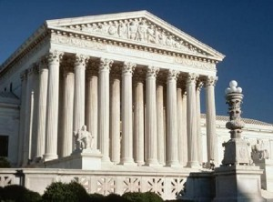 The exterior of the U.S. Supreme Court building with white stone columns and a white facade.