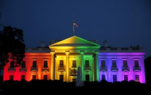 A photo of the White House with rainbow lights shown on it