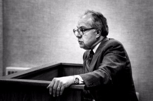 Law professor James Ghiardi stands at a podium and lectures to a class, circa 1985.