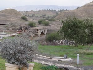 "View of stone bridge at Israeli settlement ""Old Gesher,"" located on the Jordan River."