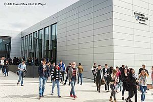 Students walk outside of the law school at Justus Liebig University in Giessen, Germany.