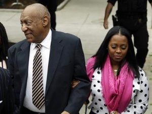 Bill Cosby and Keisha Knight Pullman walk together outside of the courtroom where he faced trial on charges of rape.