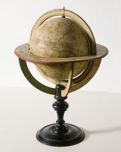 Potograph of an antique globe of the world showing the continents and nations circa the 1800s.