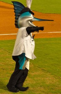 A photo of the mascot for the Florida Marlins baseball team, a man dressed in a foam costume with a fish head and wearing a baseball jersey.