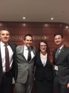 The four members of the Law School team stand side by side at the Jessup International Moot Court Competition.