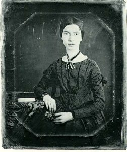 Daguerreotype showing a young Emily Dickinson seated at a table taken at Mount Holyoke Seminary in December 1847 or early 1848