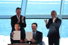 Foxconn executives and Governor Walker sign agreement at Milwaukee Art Museum