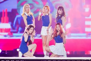 The Korean pop music group Red Velvet, consisting of five women wearing blue and white outfits, pose on a stage in Inchon, South Korea.