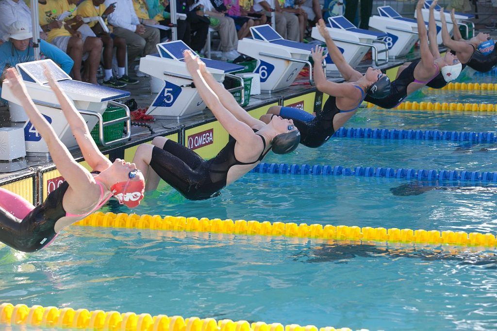 Swimmers beginning a backstroke race