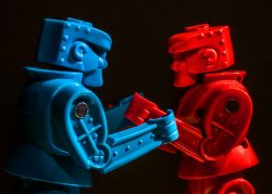 Red and blue Rock'em-Sock'em Robots facing off