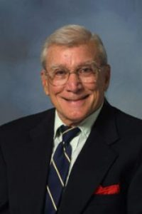 Headshot photo of Professor Ray Klitzke wearing a suit and tie.