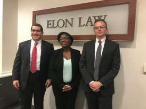 Moot Court students in front of Elon Law sign