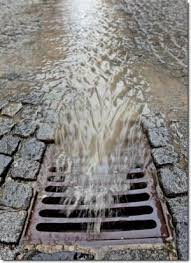 Stormwater flowing into a grate