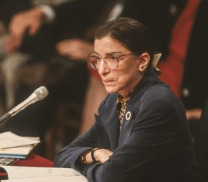 Ruth Bader Ginsburg sitting at a table during her confirmation hearings in 1993