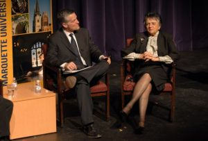 Mike Gousha sits in a chair, listening to Shirley Abrahamson talk, May 2008